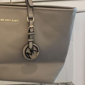 MK Michael Kors gray & gold emblem purse tag